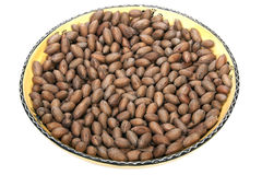 Decorative Pottery Bowl Filled with Unshelled Pecan Nuts Stock Photo