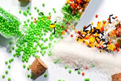 Decorative Powder for Easter cake in glass bottles on a white background.  Stock Image