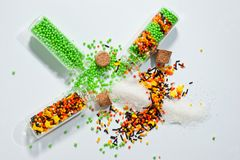 Decorative Powder for Easter cake in glass bottles on a white background.  Stock Photos