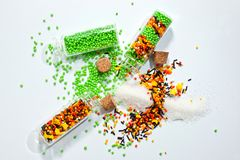 Decorative Powder for Easter cake in glass bottles on a white background.  Royalty Free Stock Image