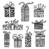 Decorative presents boxes set black doodle. Holiday season presents and gifts boxes wrapped in festive  doodle style paper pictograms collection  isolated vector Royalty Free Stock Photography