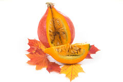 Decorative pumpkin on yellowed maple leaves Royalty Free Stock Photography