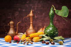 Decorative pumpkins, corn and metal jugs Stock Photo