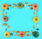 Decorative pumpkins with fall leaves frame. Royalty Free Stock Photo
