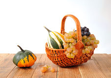 Decorative pumpkins and grapes Stock Photos