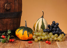Decorative pumpkins and grapes Stock Photo