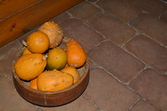 Decorative pumpkins. Decorative small pumpkins in a bowl on the pavement Stock Photo