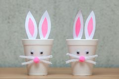 Decorative rabbits made of plastic glasses. Stock Photo