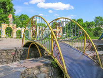 Decorative railings. With openwork bridge spans the bowl of the fountain on the playground Stock Image