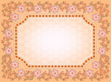 Decorative rectangular frame in orange tones with. Figured rectangular frame decorated with large flowers and maple leaves on a light orange background Stock Photography