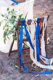 Decorative red, blue and white ribbons on chair. Decorated chairs with red bows in a row. Royalty Free Stock Image