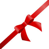 Decorative red bow with diagonally ribbon on the corner. Royalty Free Stock Photography