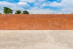 Decorative red brick wall fence on concrete floor with tree Royalty Free Stock Photo