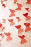 Decorative red butterflies. From a cardboard on a wall in a room Stock Photos
