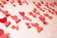 Decorative red butterflies. From a cardboard on a wall in a room Stock Images