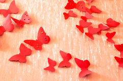 Decorative red butterflies. From a cardboard on a wall in a room Stock Photo
