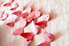 Decorative red butterflies. From a cardboard on a wall in a room Stock Photography
