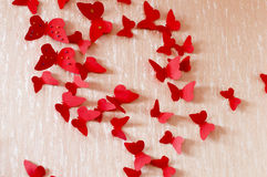 Decorative red butterflies. From a cardboard on a wall in a room Royalty Free Stock Photo