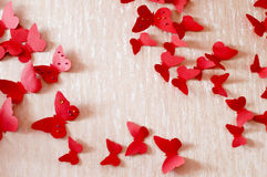 Decorative red butterflies. From a cardboard on a wall in a room Royalty Free Stock Photos