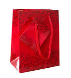 Decorative red gift bag with flower ornaments Royalty Free Stock Photo