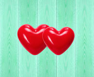 Decorative red hearts on color wooden background Royalty Free Stock Images