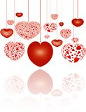 Decorative red hearts on strings Stock Photo