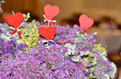 Decorative red hearts in violet flowers Royalty Free Stock Photography