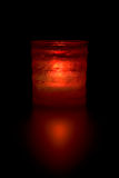 Decorative red light. In glassy container reflecting on black background Stock Images