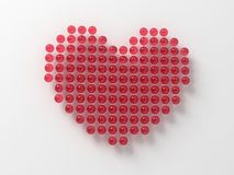 Decorative red love heart. Red glass balls forming decorative love heart, isolated on white background Royalty Free Stock Images