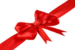 Decorative red ribbon with a bow Stock Photos
