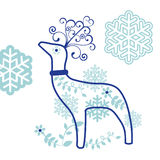 Decorative reindeer with snowflakes Stock Image