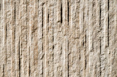 Decorative relief cladding slab imitating stone on wall Royalty Free Stock Photos