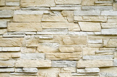 Decorative relief cladding slabs imitating stones on wall Stock Photos