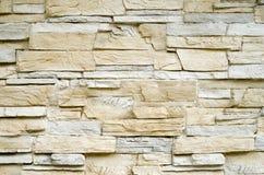 Decorative relief cladding slabs imitating stones on wall Stock Photos