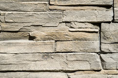 Decorative relief cladding slabs imitating stones on wall Stock Photography