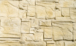 Decorative relief cladding slabs imitating stones on wall Stock Images