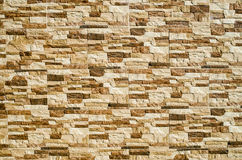 Decorative relief cladding slabs imitating stones on wall Royalty Free Stock Photos