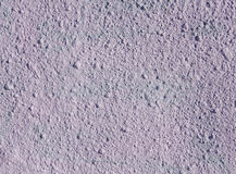 Decorative relief light purple plaster on wall Stock Photos