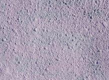 Decorative relief light purple plaster on wall Stock Photos