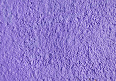Decorative relief purple plaster on wall Stock Photography