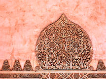 Decorative reliefs on red marble. Arabic art. Stock Photos