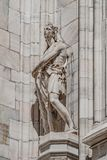 Decorative Religious figure at facade of the Cathedral of Milano, Milan, Italy royalty free stock photo