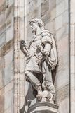 Decorative Religious figure at facade of the Cathedral of Milano, Milan, Italy stock images