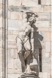 Decorative Religious figure at facade of the Cathedral of Milano, Milan, Italy royalty free stock images