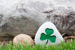 Decorative rock with a painted green shamrock Royalty Free Stock Photos
