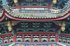 Decorative roof and eave in Buddhism temple, China. Featured and colored decorative roof and eave of South Putuo Buddhism Temple in South of China, shown as Stock Image
