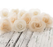 Decorative roses on the white table Royalty Free Stock Photos