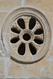 Decorative round window close-up in the ancient church, Monteneg Royalty Free Stock Image