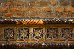 Decorative row of blue glazed tile on a old brick wall of a synagogue, Hebrew temple. Close up of decorative pattern stock photography