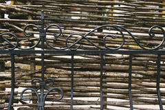 Decorative rustic village fence of wooden twigs. Garden decor stock photos